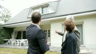 Stock Video Footage of real-estate agent with senior couple buying new house