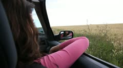 Woman riding in convertible car in countryside Stock Footage