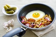 A farmer's breakfast with fried potatoes and a fried egg Stock Photos
