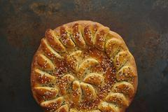 Stock Photo of Round Loaf of Decorative Bread with Sesame Seeds
