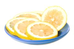 Lemon slice  in saucer Stock Photos