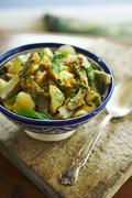 Moroccan Potato and Artichoke Salad with Harissa Dressing - stock photo