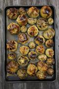 Roasted Green Heirloom Tomatoes on a Sheet Pan Stock Photos