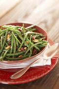 Serving Bowl of Green Beans with Marcona Almonds and Cranberries; Spoon Stock Photos