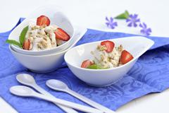 Ice cream with cereals, strawberries and mint - stock photo