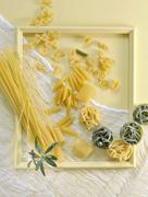 Various types of pasta in a picture frame Stock Photos