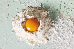 Egg yolk on flour Stock Photos