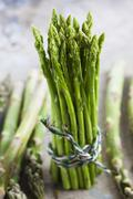 A bundle of green asparagus - stock photo