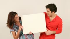 Couple holding white board Stock Footage