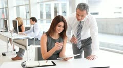 Business people in office with electronic tab Stock Footage