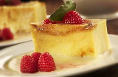 Bread pudding with Raspberries and White Chocolate Sauce Stock Photos