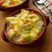 Chicken Noodle Soup Made with Wide Egg Noodles; In a Bowl Stock Photos