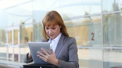 businesswoman using touchpad on business travel - stock footage