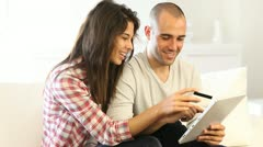 young couple using electronic tablet at home - stock footage