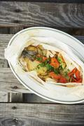 Trout en Papillote with Vegetables and Parsley - stock photo