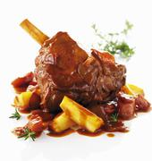 Leg of lamb with root vegetables - stock photo