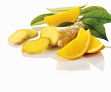 Ginger and slices of orange Stock Photos