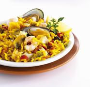 Paella with mussels, shrimp and mushrooms Stock Photos