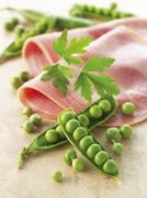 Peas and boiled ham - stock photo