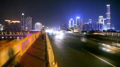 Six lane bridge over river with traffic during the night Stock Footage