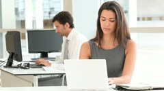 Attractive businesswoman working on laptop computer Stock Footage