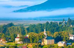 Stock Photo of summer misty morning country view.