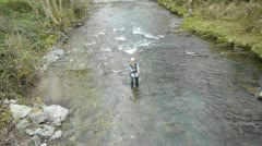 upper view of woman fly-fishing in river - stock footage
