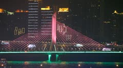 Haiyin bridge close up at night with traffic and ships Stock Footage