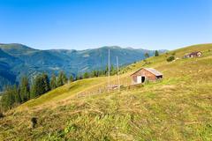 Summer mountain farmyard Stock Photos