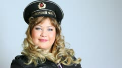 Pretty woman with Black sea Fleet army hat and binocle posing Stock Footage