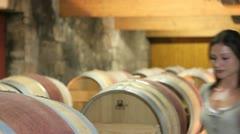 winemaker in winery tasting red wine - stock footage