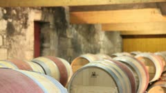 winemaker talking to camera in winery - stock footage