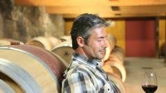 Winemaker tasting red wine in cellar Stock Footage