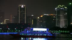 Pearl river and city at night with a touristic vessel Stock Footage