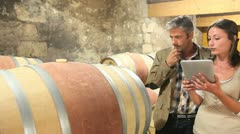 winemaker talking to client in winery - stock footage