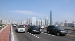 Six lane street on Guangzhou bridge with traffic ground view Stock Footage