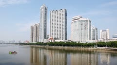 Pearl river in Guangzhou on daylight with city in distance Stock Footage