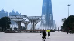 Square with fountains and Canton Tower in distance daylight Stock Footage