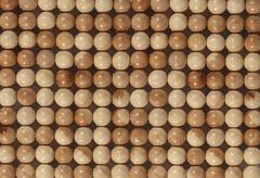 Texture from wooden marbles Stock Photos
