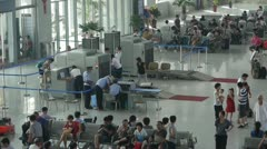 Busy entrance to airport & railway station.waiting hall. Stock Footage