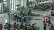 Stock Video Footage of Busy entrance to airport & railway station.waiting hall.