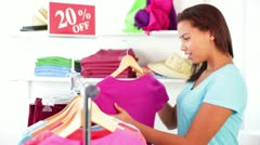 Attractive African-American Young Woman Going Crazy at Clothing Sale - stock footage