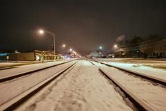 snow covered train tracks - stock photo