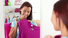 Attractive African-American Woman with Clothes & Shopping Bag before Mirror Stock Footage