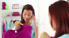 Attractive African-American Young Woman Talking on Phone in front of Mirror Stock Footage