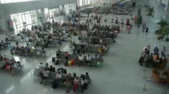 Many people in busy waiting hall.entrance to airport & railway station. Stock Footage
