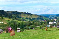 Summer mountain village Stock Photos