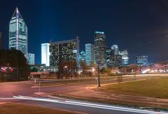 skyline of uptown charlotte, north carolina at night. - stock photo