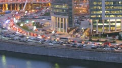 Evening view of traffic andNaberezhnaya Tower in New City Stock Footage