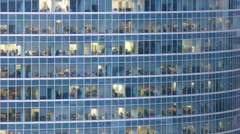 Office building viewed in the evening. Time lapse - stock footage